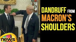 President Trump Wipes Off Dandruff From President Macron's Shoulders | Mango News - MANGONEWS