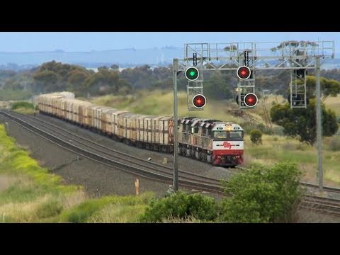 SCT Freight Train crosses V/line Passenger Trains - PoathTV Railroads and Trains in Australia