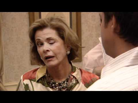 Lucille Bluth, from Arrested Development, winking grotesquely