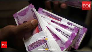 Rupee at new low, breaches 70-mark against USD - TIMESOFINDIACHANNEL