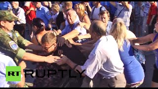 Scuffles break out as people gather in memory of Odessa massacre victims - RUSSIATODAY