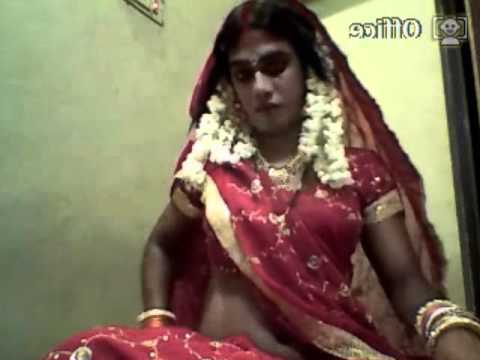 indian cross dresser bride in red sares....preparation for marrige ...