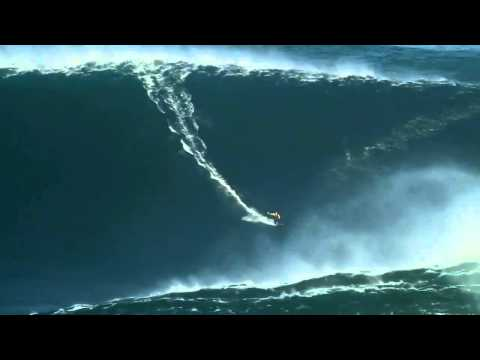 World record Surfing a 90 ft wave in Nazare Portugal HD