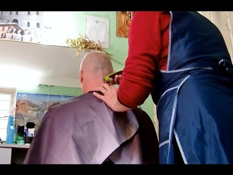 Clippers head shave at female barber