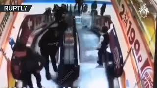 Child sends younger kid down mall escalator in trolley - RUSSIATODAY
