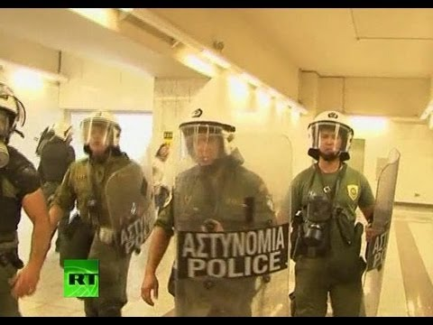Video Riot police storm Athens metro during strike demo