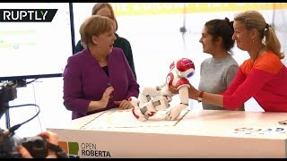 Merkel gets goofy while toying with robot at German Chancellery - RUSSIATODAY