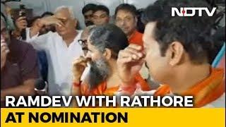 Rajyavardhan Rathore Does 'Pranayam' Before Nomination, Ramdev By His Side - NDTV