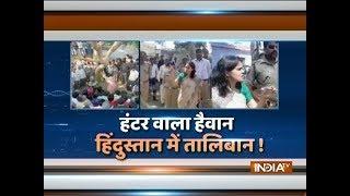 UP: Husband beats woman in public on Panchayat's order - INDIATV