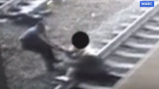Cop Saves Man Seconds Before Train Arrives - ABCNEWS