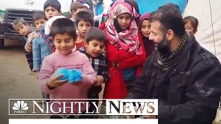 Meet 'The Toy Smuggler' Risking His Life To Bring Joy To Syria's Children | NBC Nightly News - NBCNEWS