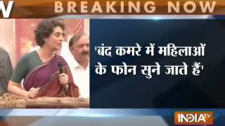 Priyanka Gandhi hits out at Modi for spying women - INDIATV