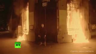 Russian shock artist Pavlensky sets Bank of France entrance ablaze - RUSSIATODAY