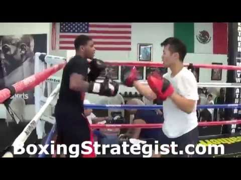 Chi-Tao Li Mittwork with Money Mike Fowler at the Mayweather Boxing Club