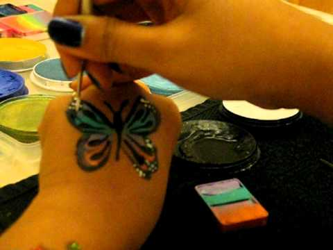 Face Painting Butterfly Cheek Art Using a Fan Brush