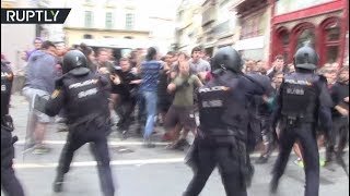 Clashes erupt as cops evict squatters of occupied community center in Spain - RUSSIATODAY