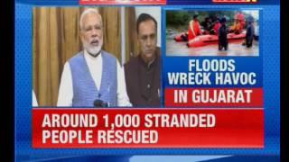 Prime Minister Narendra Modi undertakes aerial survey of flood hit areas - NEWSXLIVE
