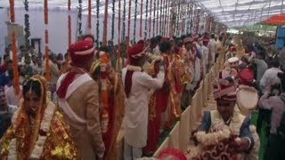 Amroha: 121 couples tie the knot in mass marriage ceremony - TIMESOFINDIACHANNEL