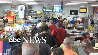 People rush out to buy lottery tickets for the now-$1.6 billion jackpot - ABCNEWS