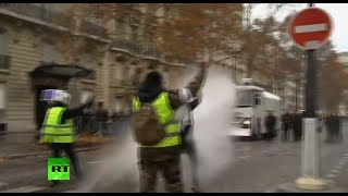 Police unleash water cannon on 'Yellow Vests' protesters in Paris - RUSSIATODAY