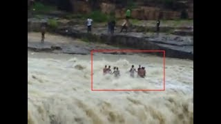 On cam: Several people swept away in flash flood in MP's Shivpuri - TIMESOFINDIACHANNEL
