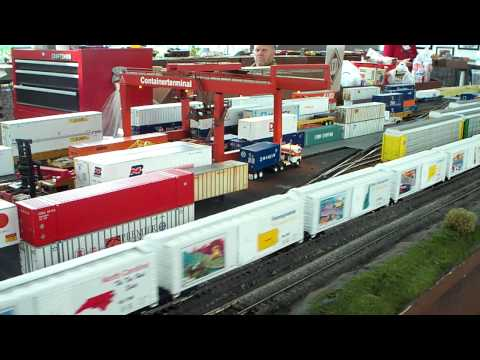 US Mail engine leads the USPS postal cars past the Heljan container crane yard