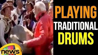 PM Modi Performs Ritual Of Playing Traditional Drums Outside Muktinath Temple in Nepal | Mango News - MANGONEWS
