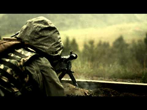 Super slow motion shot of soldier shooting chain gun.