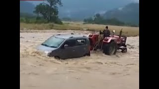 Watch: Tractor rescues car from washing away in Uttarakhand - TIMESOFINDIACHANNEL