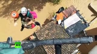 RAW: Stranded resident rescued via helicopter from flooded town in Spain - RUSSIATODAY