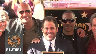 Eddie Murphy and The Rock witness Brett Ratner's Hollywood honor. - REUTERSVIDEO