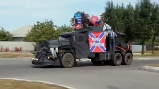 RAW: Militia parade military vehicles through streets of shelled Lugansk, E. Ukraine - RUSSIATODAY