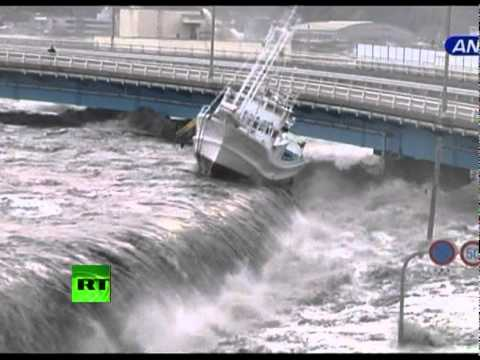 Tsunami Wave Spills over Seawall, Smashes Boats, Cars
