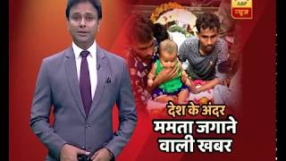 Martyr's five-month-old daughter sits on his coffin, Jhalawar collector writes an inspirat - ABPNEWSTV