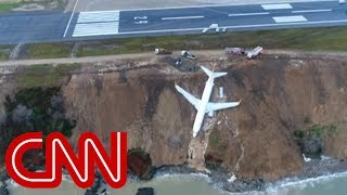 Plane skids off runway, gets stuck on cliff - CNN