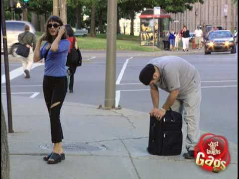 JFL Prank: Suitcase bolted to sidewalk