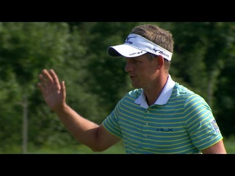 Luke Donald confidently rolls in his 26-foot birdie putt at RBC Canadian