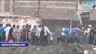 بالفيديو والصور..الأهالي يودعون جثمان النقيب محمود طه في بلدته بالدقهلية