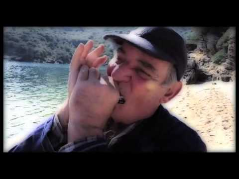 Captain Panos plays his harmonica #3  on Sarakiniko Beach, ithaca