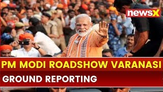 Varanasi people react on PM Narendra Modi roadshow, public chants Modi-Modi slogan | Elections 2019 - NEWSXLIVE