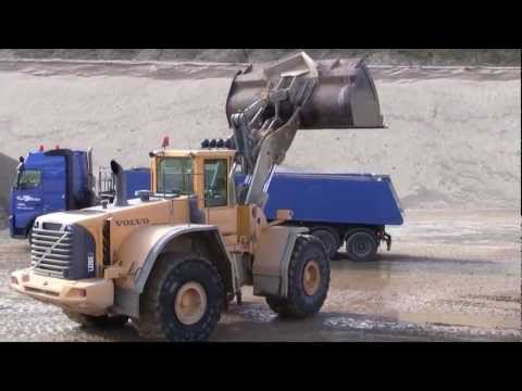 Volvo L220E Loading Volvo FH12 480 Truck And Filling The Mixing Plant