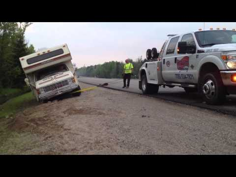 Rv motorhome almost flipping over is saved by CAA towing truck