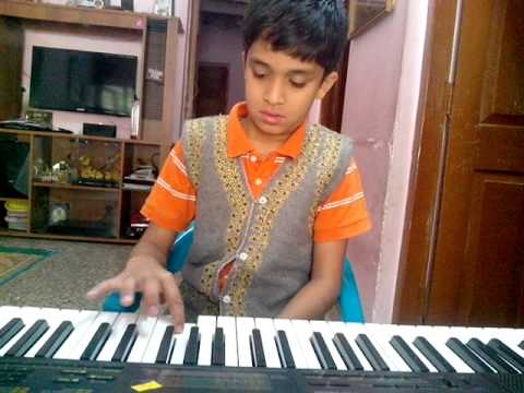 Nischal playing keyboard-Raghupathi ragahv-krish3
