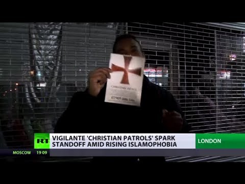Far-right 'Christian patrols' in UK spark standoff with Muslims using leaflets & beer