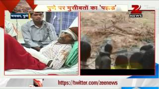 Zee Media team visits Pune landslide victims in hospital - ZEENEWS