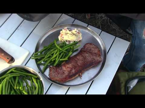 Firebox Stove, Wood Fire Grilled New York Steak, Sautéed Garlic Mashers With Steamed Green Beans.