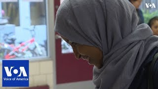 Somali-American candidate for Congress Ilhan Omar votes in primary - VOAVIDEO