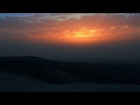 Stock Footage of an orange, cloudy sunset in Israel.