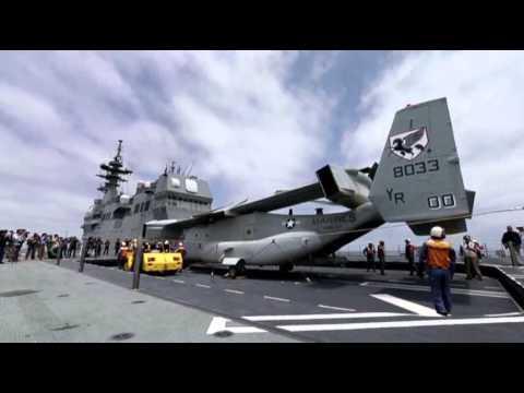 Raw: Marines Land Osprey on Japanese Ship