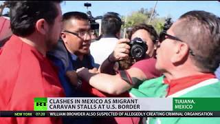 Clashes in Mexico as migrant caravan stalls at US border - RUSSIATODAY